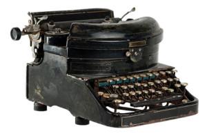 Antique typewriter isolated on white
